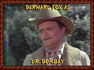 Bernard Fox as Dr. Bombay